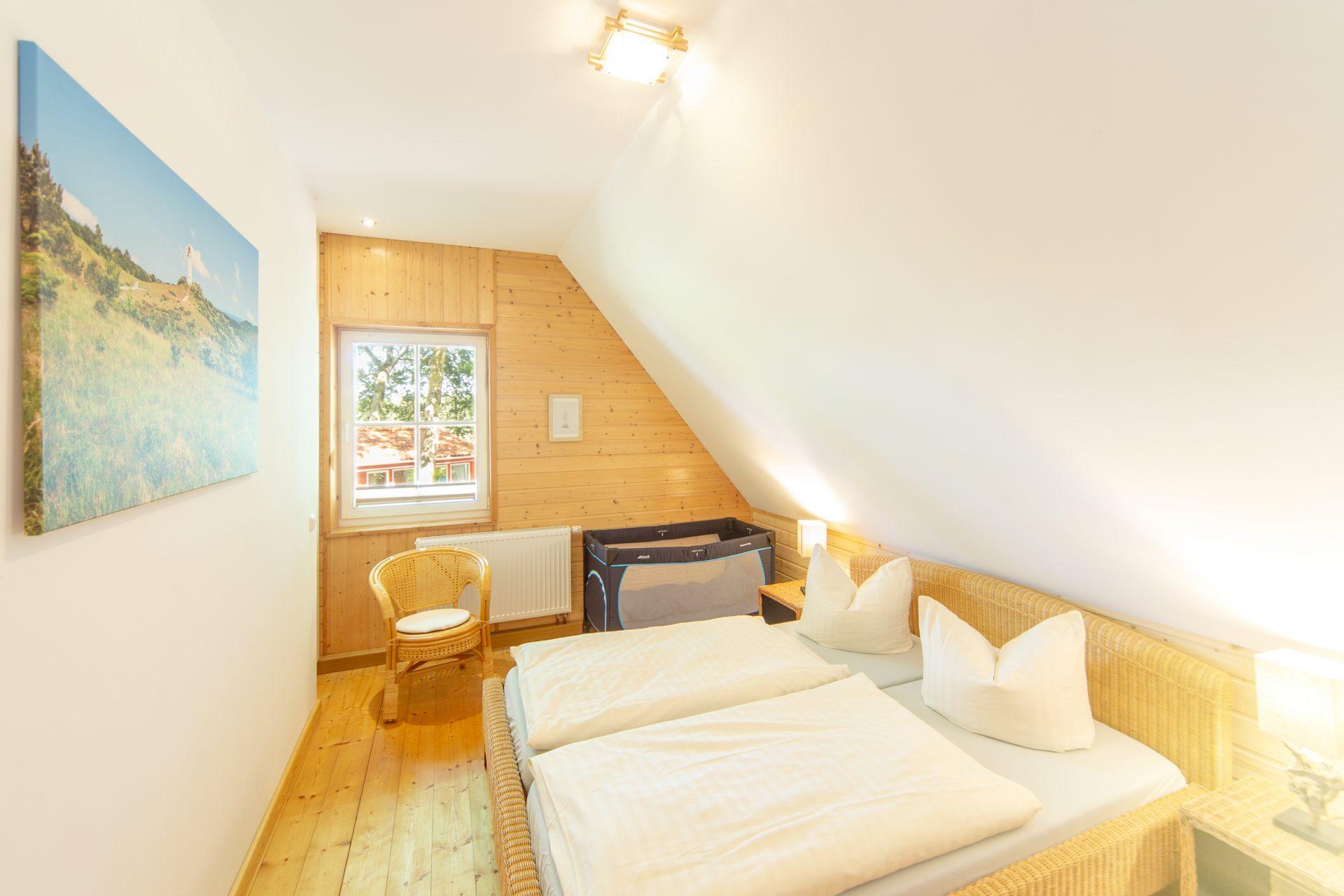 Schafzimmer mit Doppelbett